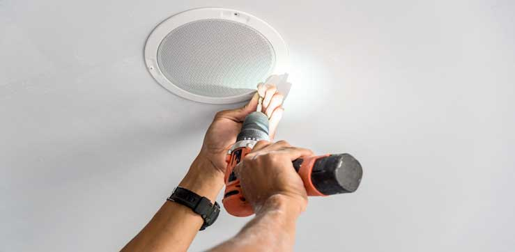 Technician Installing Ceiling Speaker